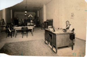 "Clifton ""C. F."" Richardson behind his desk at the Houston Informer, 1920s"